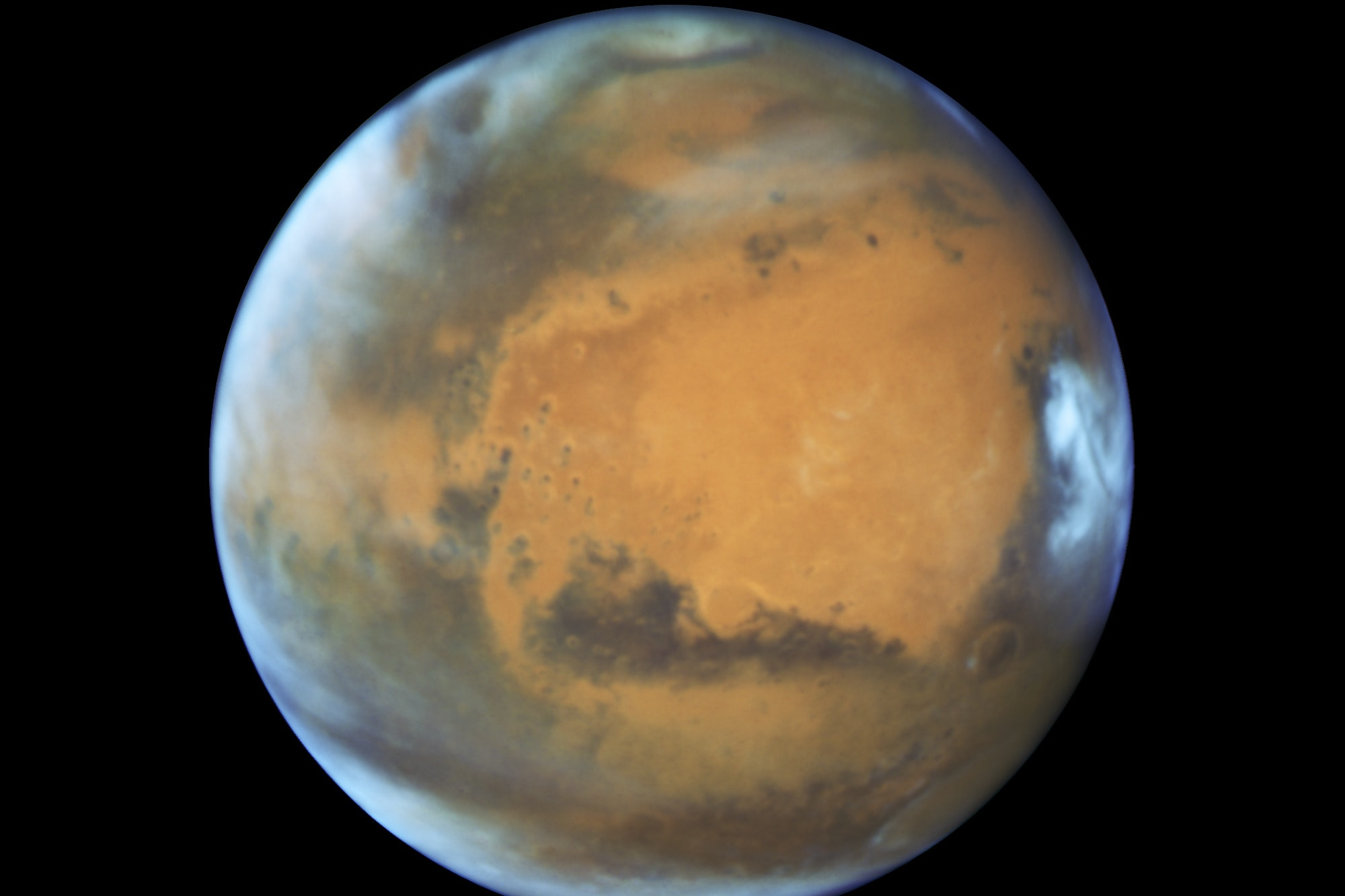 A 12-mile wide lake of liquid water has been discovered below the Martian southern ice cap increasing the possibility of life on the planet