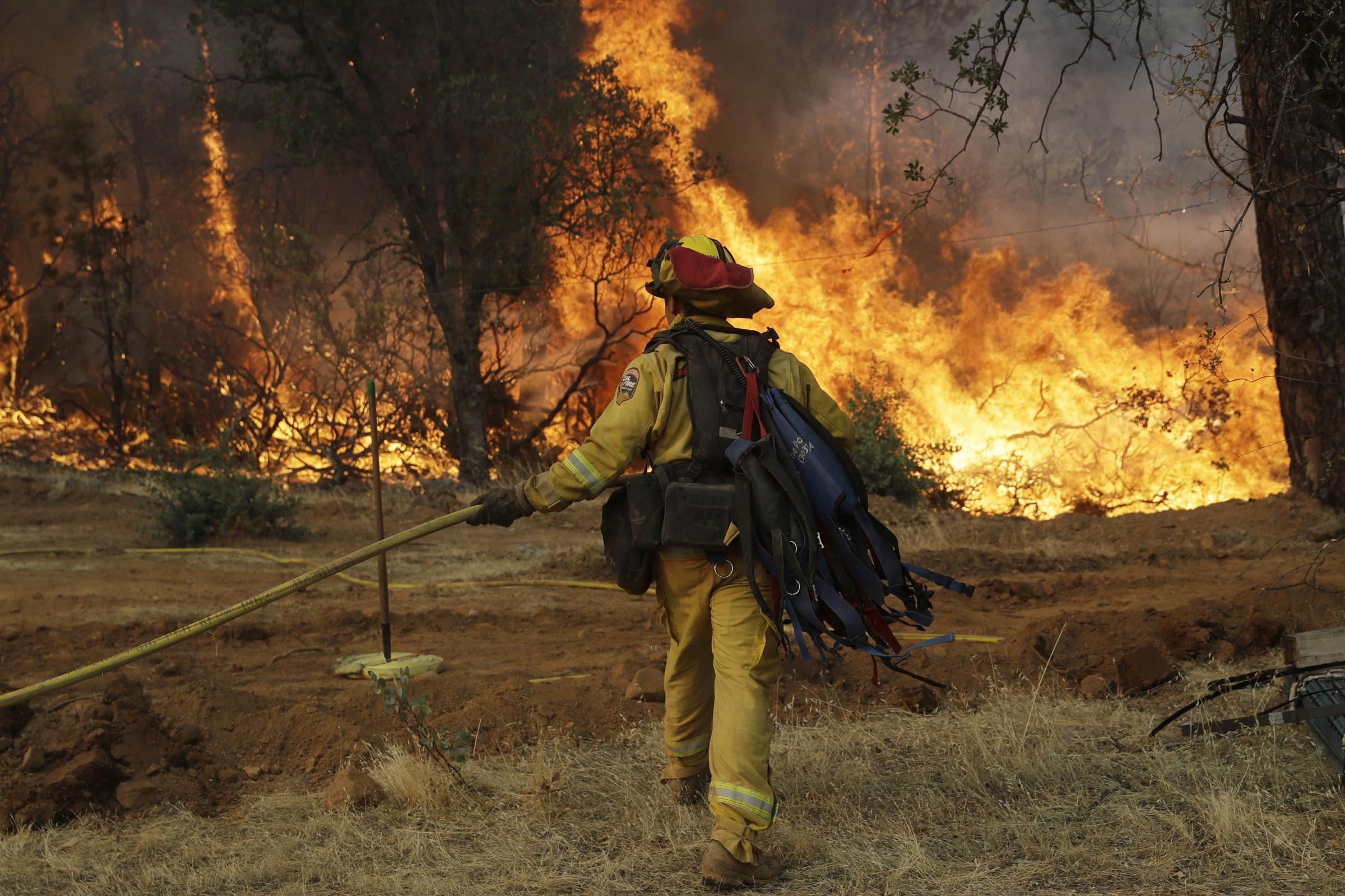 Thousands Flee as Wildfire Ravages California
